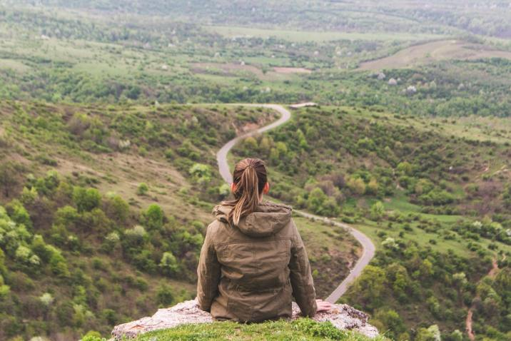 Woman finding her way on a mountain path