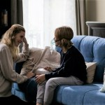 Mother creating a healing environment for child on couch