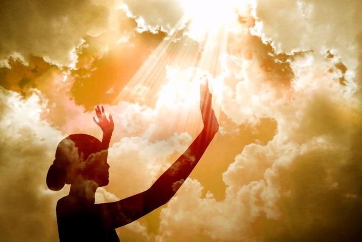 Woman raising arms to the sky - Introduce Yourself to God