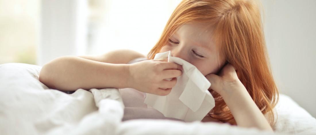 Girl blowing nose - needs a nasal saline flush