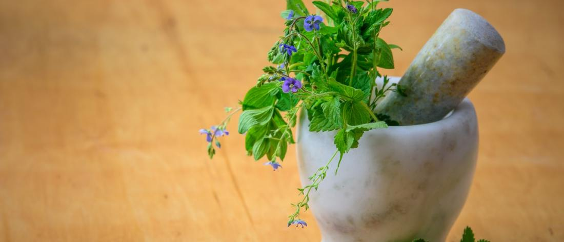 Flowers with mortar and pestle - natural flower remedies