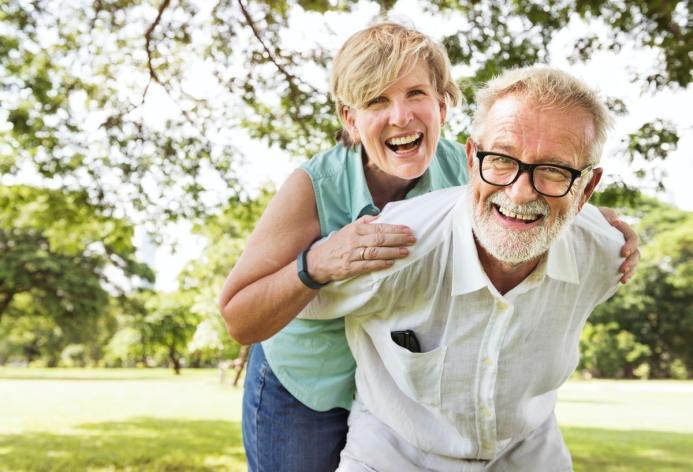Optimistic couple in park enjoying longevity
