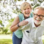 Optimistic couple in park enjoying longevity