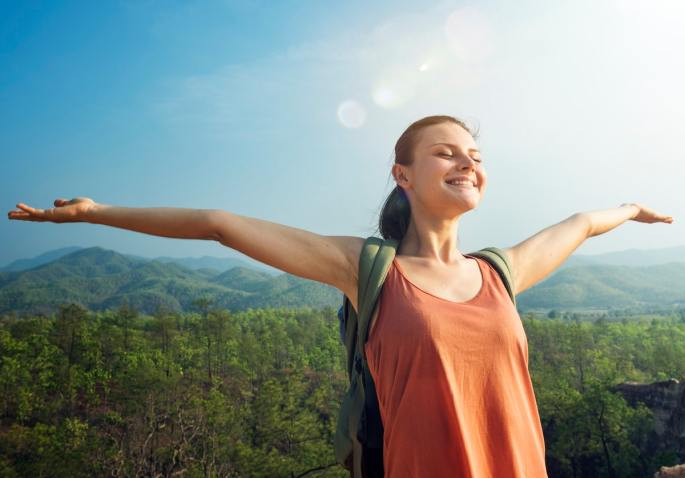 Woman outdoors breathing for Progressive Relaxation