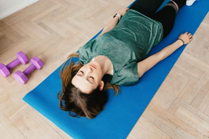 Progressive Relaxation - Woman laying on a mat