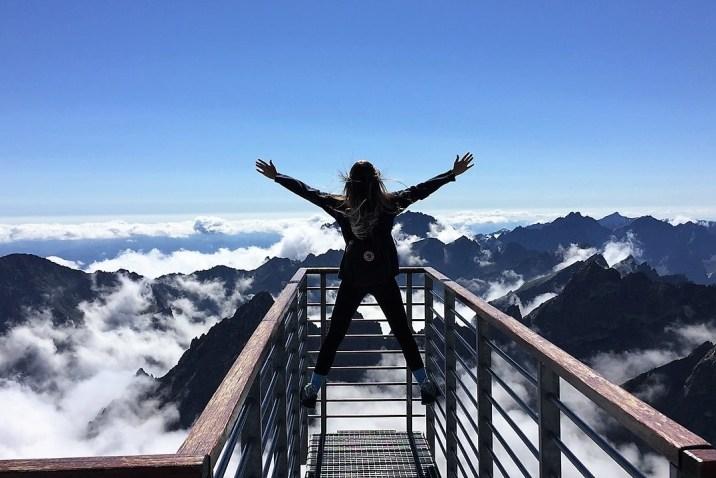 Woman reaching potential climbing mountain