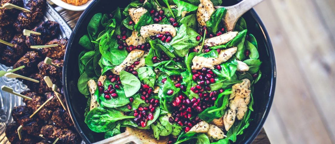 Bowl of spinach and chicken salad