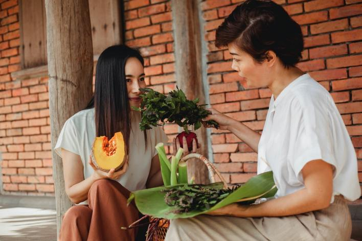 Woman eating fruits and herbs for improved health