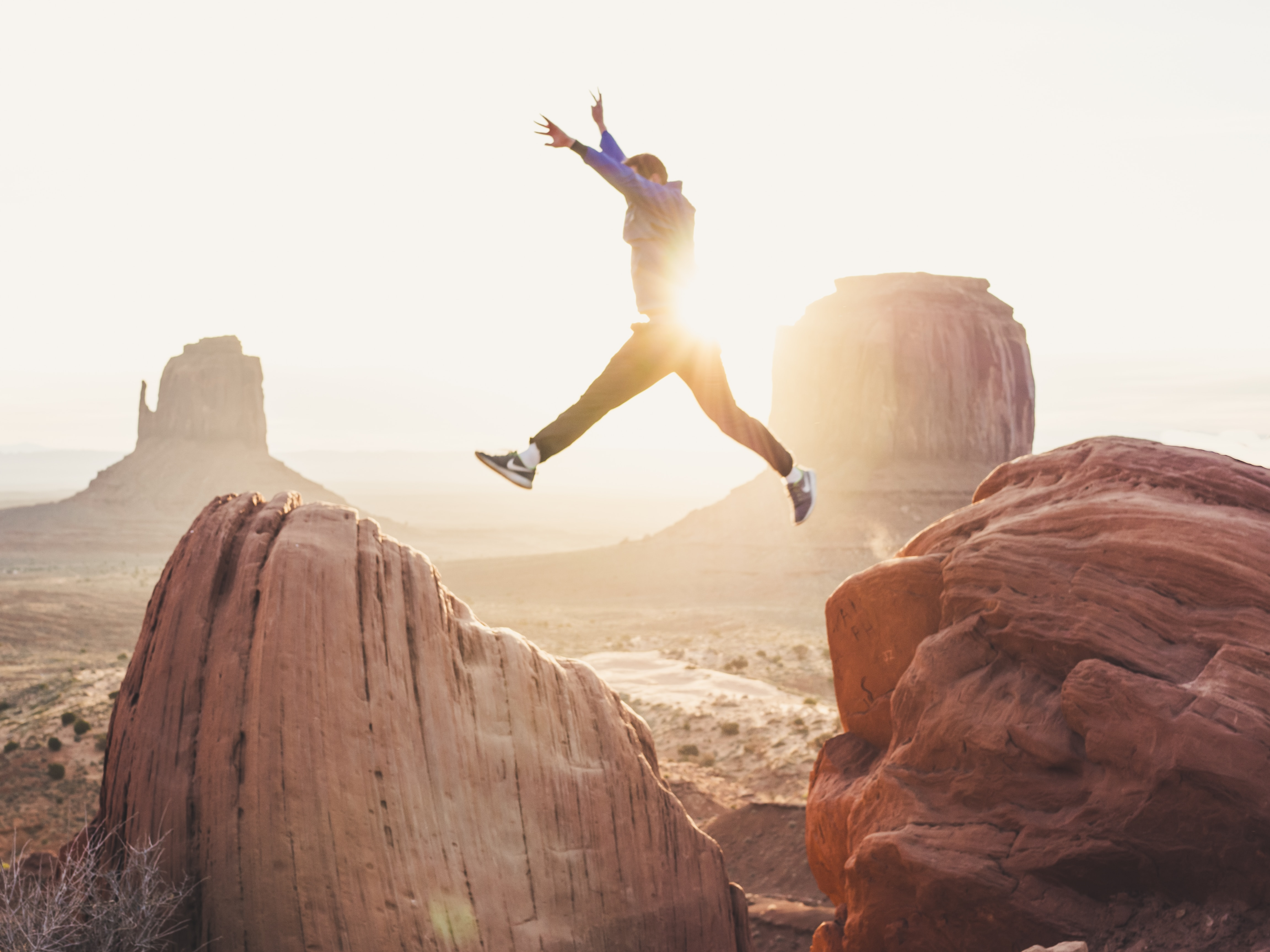 Person leaping across a chasm