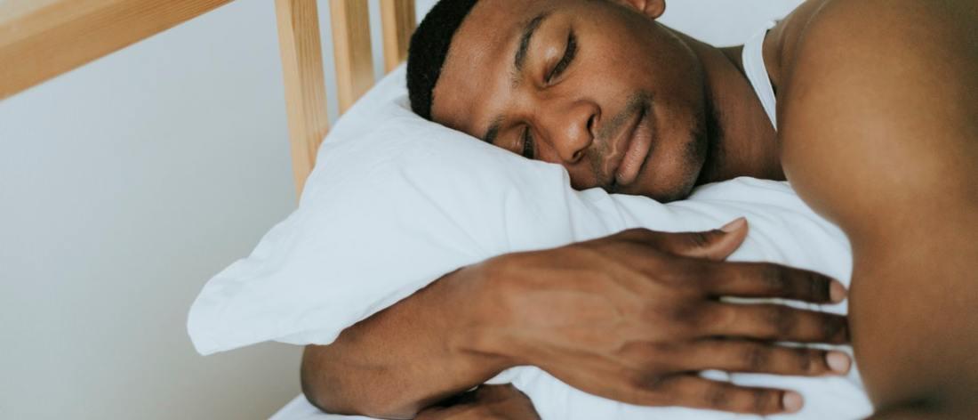 Man who exercises sleeping well