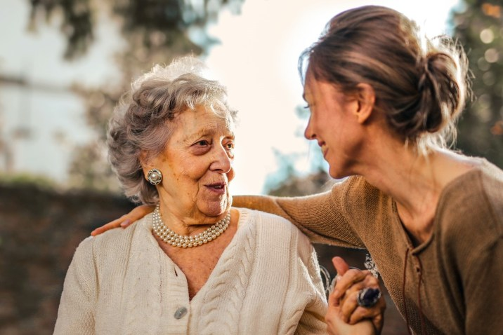 Elderly woman sitting with daughter
