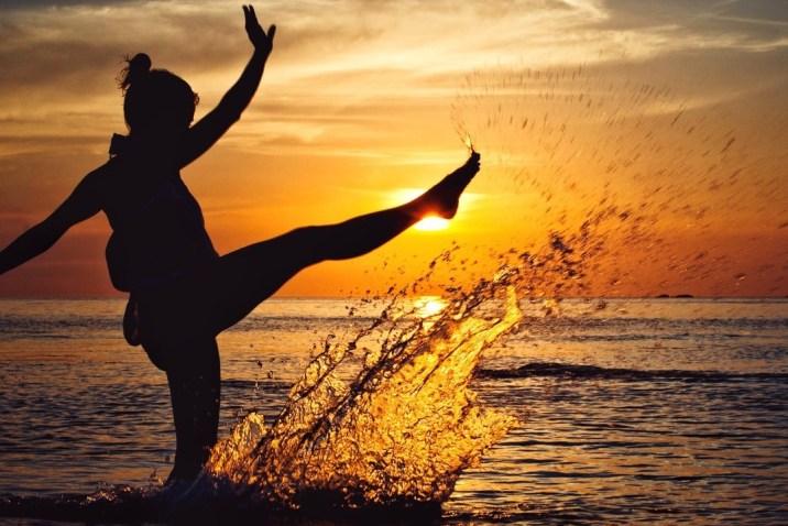 Joyful detached woman on beach