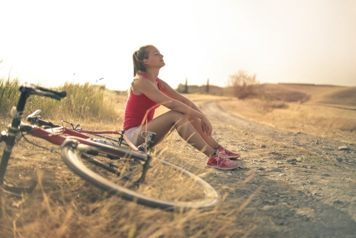 Woman with bike contemplating her life journey and inner purpose