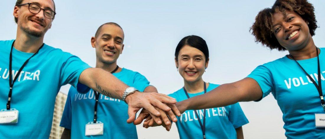 Group of volunteers holding hands
