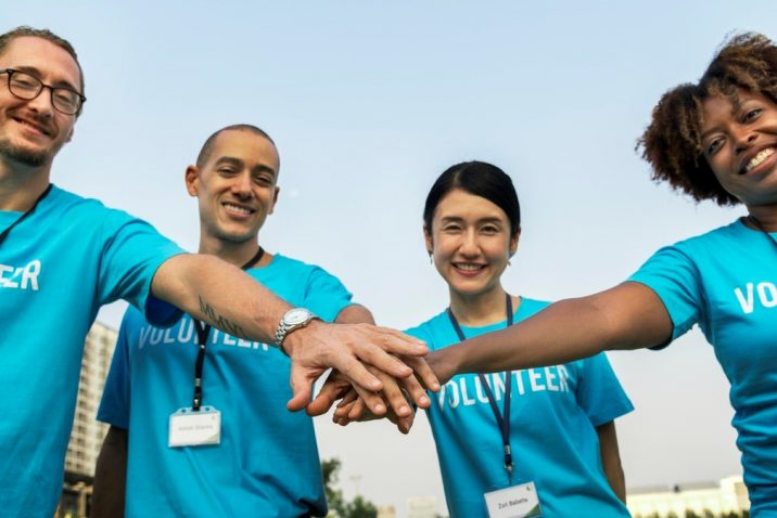 Group of volunteers holding hands