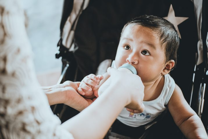 Baby drinking breast milk from a bottle
