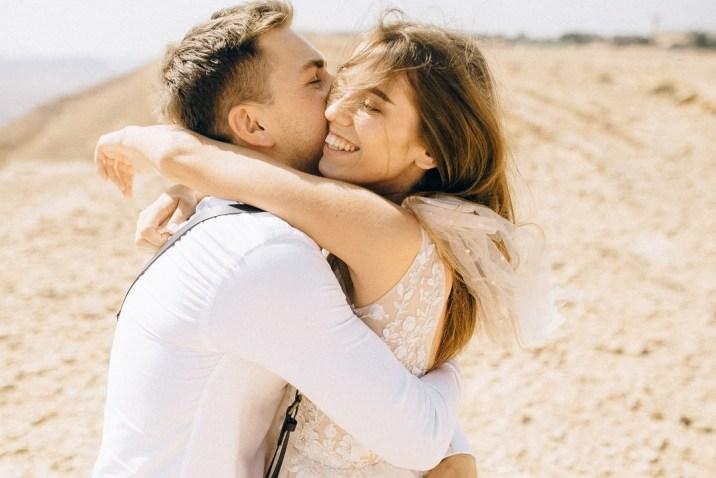 Loving couple hugging on beach