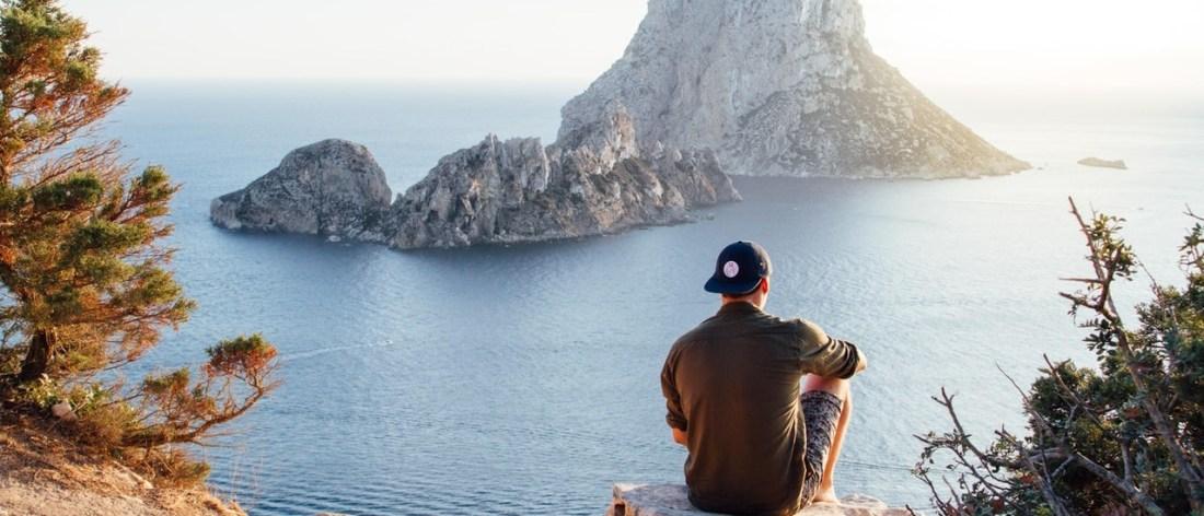 Man overlooking view the ocean, enjoying a spiritual vacation