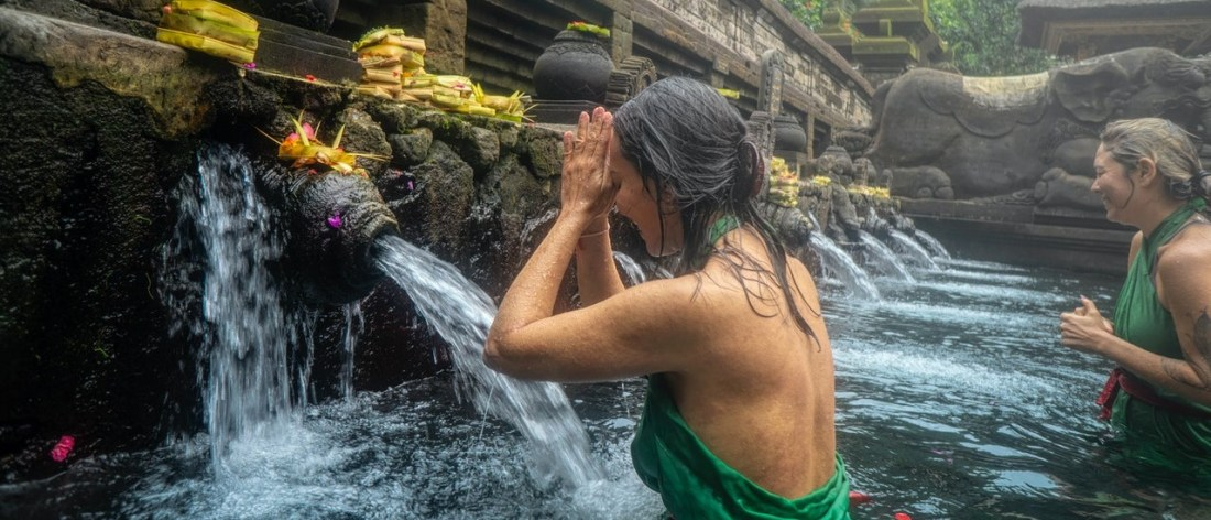 Woman with faith praying in healing water
