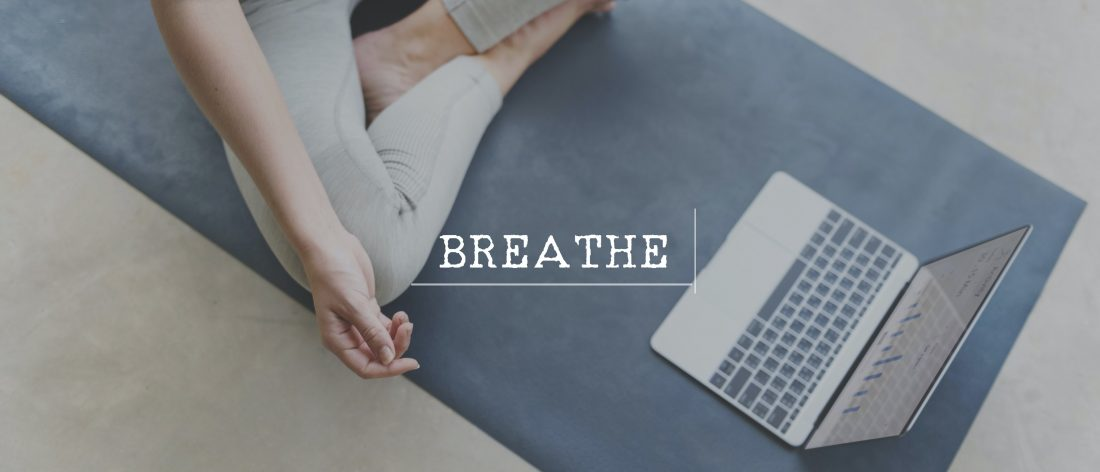 Woman at computer breathing calmly