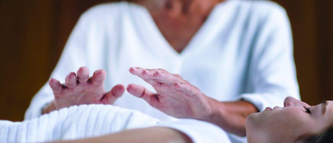 Woman receiving Reiki therapy
