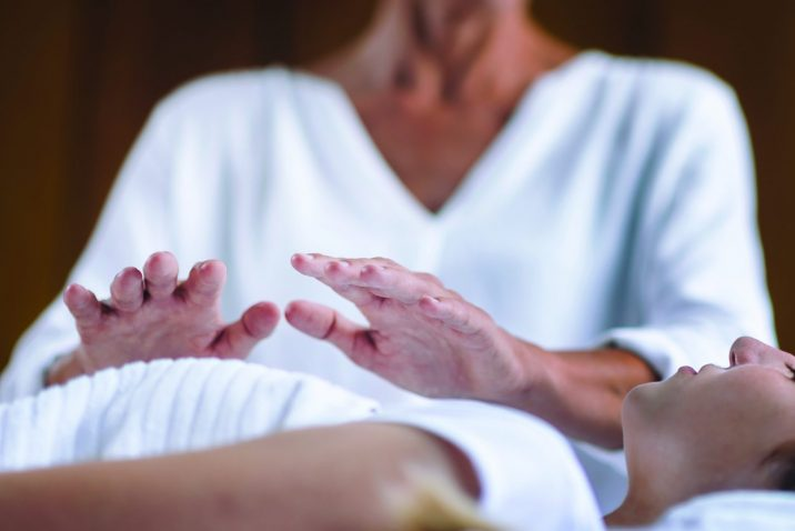 Woman receiving Reiki therapy