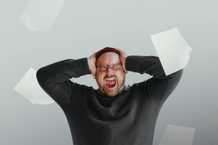 Man holding his head and experiencing modern stress