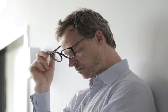 Man removing glasses