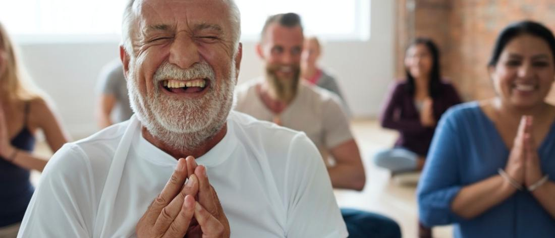 Happy people doing yoga- building a strong health foundation