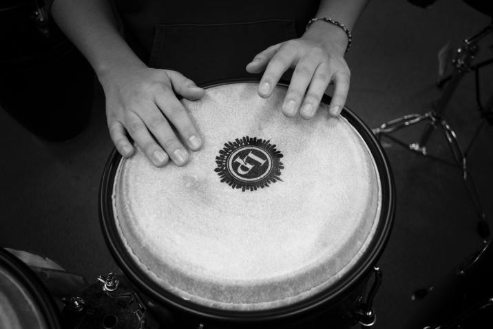 Hands with rhythm beating on a drum