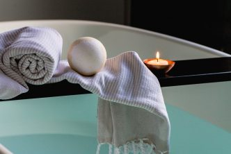 Bathtub with candle and bath salts