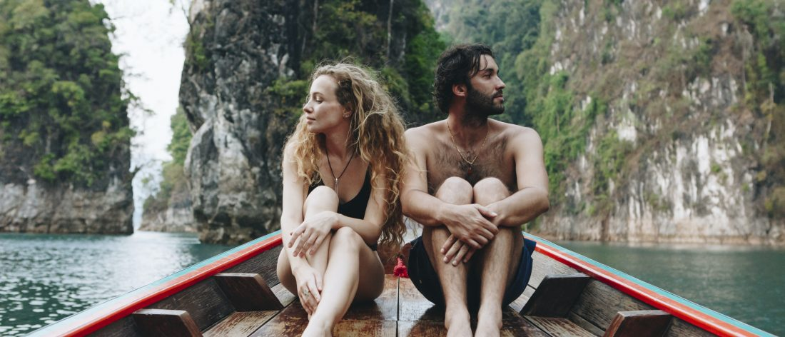 Couple arguing in a boat while on vacation