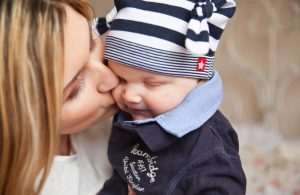 Mother kissing a sick child
