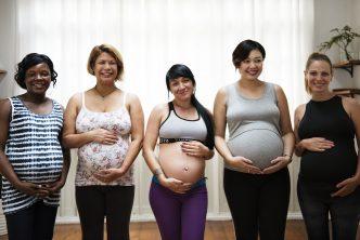 Multiple pregnant women posing