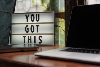 "Sign saying ""You Got This"" next to a computer"