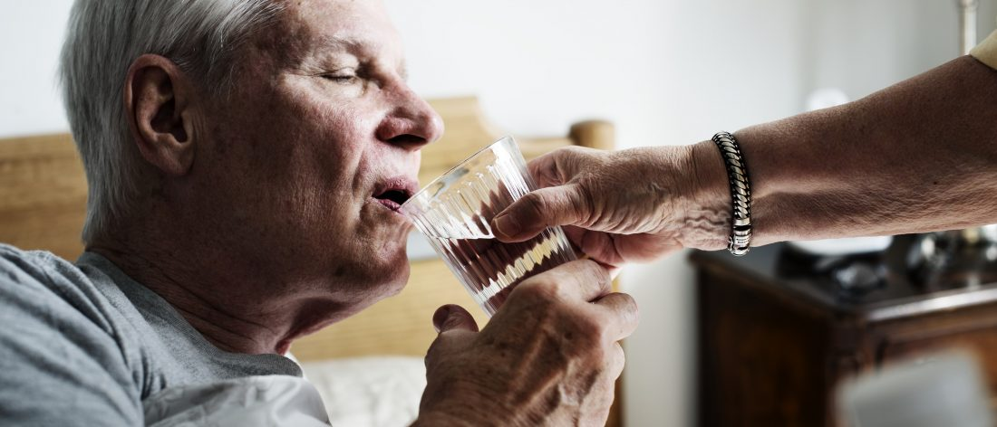 Elderly man taking Rember