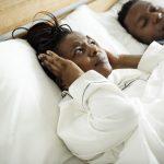 Woman suffering from her partner's Sleep Apnea