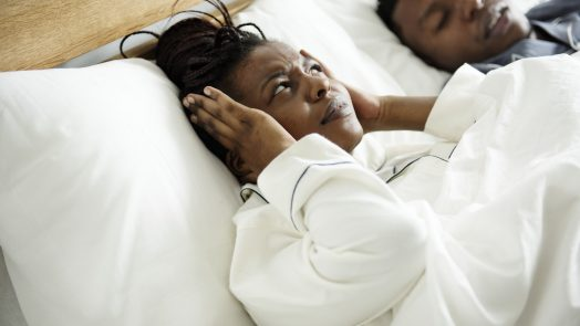 Woman suffering from her partner's Sleep Apnea