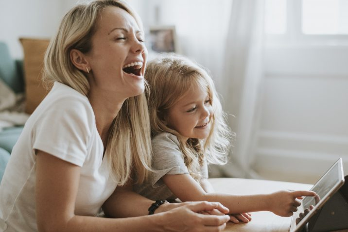 Mom and daughter laughing at life