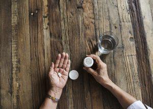 A woman taking a prescription painkiller