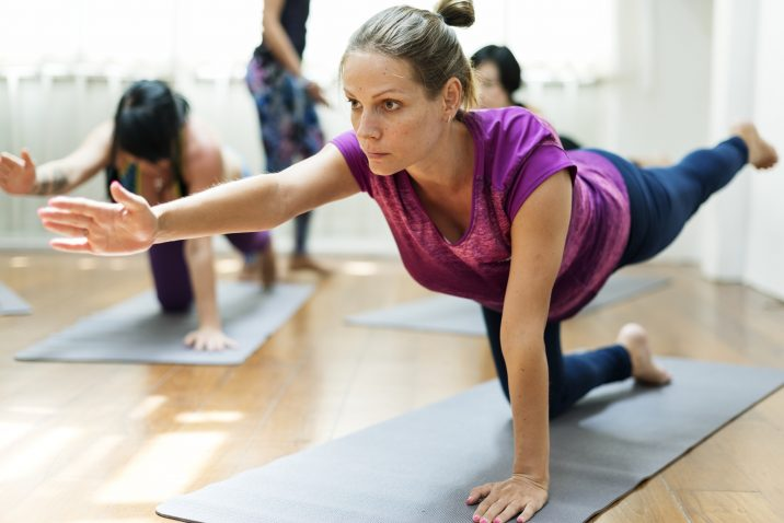 Woman performing a pose at a Yoga class