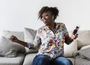 Woman loving life while listening to music