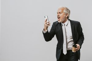 Man screaming into his cell phone
