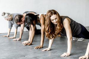 Strong women doing pushups