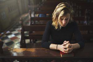 A woman praying in earnest