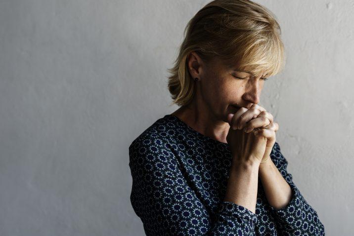 Woman Praying and Finding Spiritual Companionship