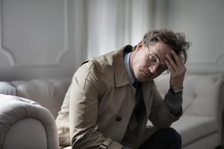 Man with core negative beliefs sitting and thinking