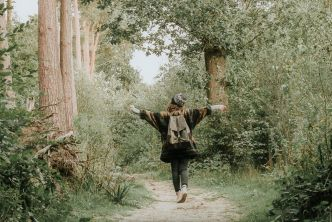 Woman walking on a path, experiencing well being