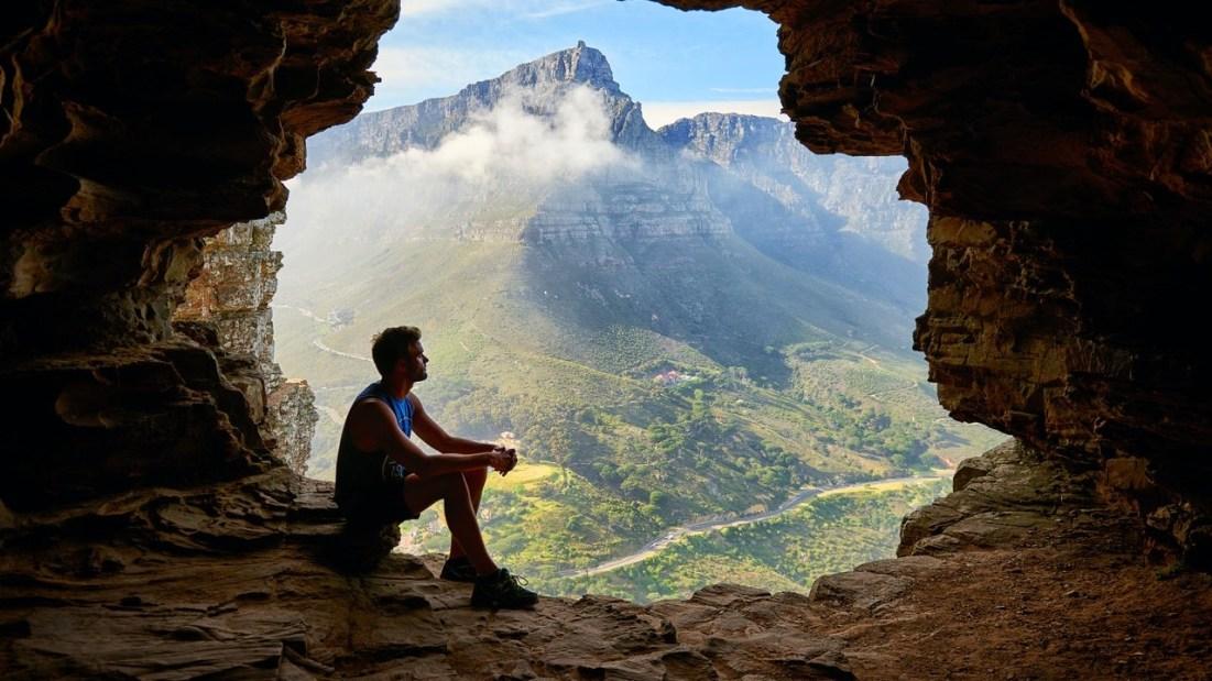 Man on mountain - choose peace