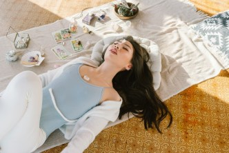 Woman laying on floor developing her spiritual self